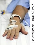 iv solution in a patients hand   Shutterstock . vector #1031664925