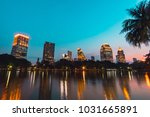 cityscape sunset of lakeside at ... | Shutterstock . vector #1031665891