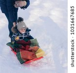 little boy enjoying a sleigh... | Shutterstock . vector #1031667685