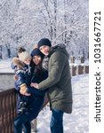 happy family outdoors. snow... | Shutterstock . vector #1031667721