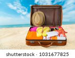 travel suitcase with beach hat  ... | Shutterstock . vector #1031677825