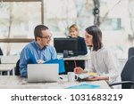 colleagues working on a project ... | Shutterstock . vector #1031683219
