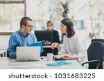 colleagues working on a project ... | Shutterstock . vector #1031683225