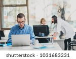 intern at the office working on ... | Shutterstock . vector #1031683231