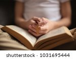 little boy with bible and cross ... | Shutterstock . vector #1031695444
