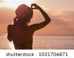 silhouette of a young girl... | Shutterstock . vector #1031706871