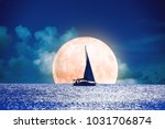 silhouette of a boat with full... | Shutterstock . vector #1031706874