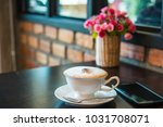 white cup of cappuccino coffee... | Shutterstock . vector #1031708071