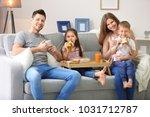 happy family having breakfast... | Shutterstock . vector #1031712787