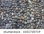 the wall made of stone pebbles... | Shutterstock . vector #1031720719