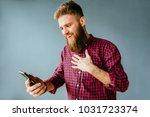 emotional portrait of beard... | Shutterstock . vector #1031723374
