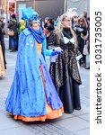 Small photo of STUTTGART, GERMANY - FEBRUARY 13: two women in lavish masks walking. Shot at Carnival parade in city center on feb 13, 2018 Stuttgart, Germany