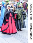 Small photo of STUTTGART, GERMANY - FEBRUARY 13: women in lavish masks walking. Shot at Carnival parade in city center on feb 13, 2018 Stuttgart, Germany