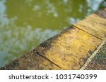 concrete walkway near the canal | Shutterstock . vector #1031740399