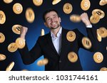 happy businessman and bitcoins... | Shutterstock . vector #1031744161