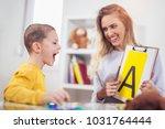 speech therapist teaches the...   Shutterstock . vector #1031764444