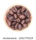 Small photo of top view of coffee beans in the glass with writhe background
