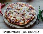fresh rustic hawaiian pizza on...   Shutterstock . vector #1031800915