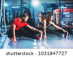 a guy and a girl in a gym doing ... | Shutterstock . vector #1031847727
