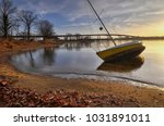 A Listing Sailboat Rests Near...