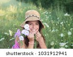 smiling girl in flower field | Shutterstock . vector #1031912941