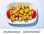 walnut in green olives from... | Shutterstock . vector #1031924467