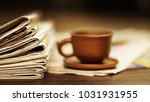 newspapers and cup of coffee.... | Shutterstock . vector #1031931955