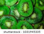 green tasty bright kiwi... | Shutterstock . vector #1031945335