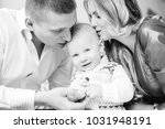 little boy looks at the camera... | Shutterstock . vector #1031948191