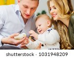 father holds a little yellow... | Shutterstock . vector #1031948209