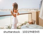 woman with champagne glass... | Shutterstock . vector #1031948545