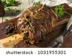 roasted stuffed leg of lamb... | Shutterstock . vector #1031955301