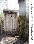 A Picture Of An Outhouse In Th...