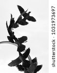 birds taking flight sculpture | Shutterstock . vector #1031973697