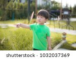 two year old in green... | Shutterstock . vector #1032037369