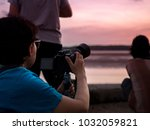 photographers are taking photos ... | Shutterstock . vector #1032059821
