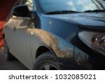 dirty black car on a sunny day | Shutterstock . vector #1032085021