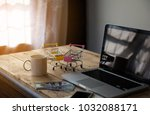 the shopping cart on labtop | Shutterstock . vector #1032088171