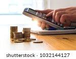 man using calculator to count... | Shutterstock . vector #1032144127