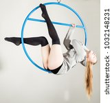 aerial acrobat on a ring. a... | Shutterstock . vector #1032148231