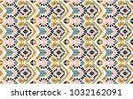 ikat geometric folklore... | Shutterstock .eps vector #1032162091