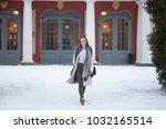 beautiful young woman walking... | Shutterstock . vector #1032165514