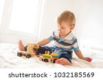 little adorable boy playing... | Shutterstock . vector #1032185569