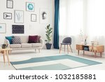 blue carpet and wooden cupboard ... | Shutterstock . vector #1032185881