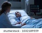 nurse supporting weak  senior... | Shutterstock . vector #1032189559