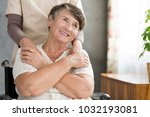 happy grandmother supported by... | Shutterstock . vector #1032193081