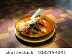 a delicious bowl of flat noodle ... | Shutterstock . vector #1032194041