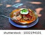 a delicious bowl of noodle soup ... | Shutterstock . vector #1032194101