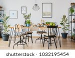 chairs at table in cozy dining... | Shutterstock . vector #1032195454