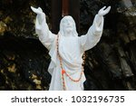 Small photo of Statue of Jesus Christ with hands raised to the sky. Concepts - faith, love, christian religion